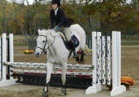 Elaina Plott jumping a 3' fence